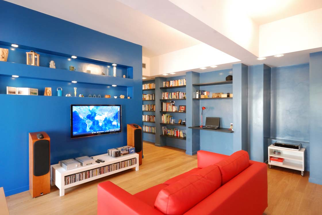 A HOUSE WITH COLOURED WALLS FOR READING AND LISTENING TO MUSIC